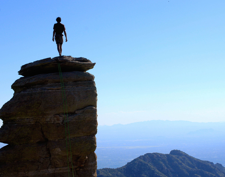 Mark Mellott looks over the city of Tucson after climbing Hitchcock Pinnacle, a popular climbing rock on Mount Lemmon, on Sept. 27. 2015. Mellott is an avid climber and a chemical engineer student at the UA. (Photo: Tobey Schmidt)