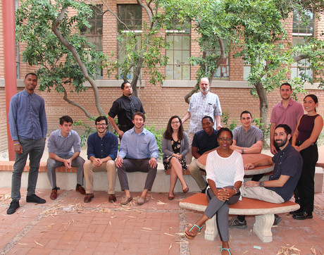 The current Bridge to Doctorate cohort students, with UA faculty and staff. Back row, left to right: Terrance DeLisser, Zachary Binger, Joseph Moya, Samuel Cabral, Nathan Reiland, Erica Vanover, UA professor Jim Field, Pierce Longmire, Joseph Agosttini, Jorge Castro Maldonado. Front row, left to right: UA program coordinator Shetara OliwoOlabode, Andres Zuniga, Anissa McKenna.
