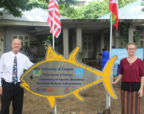 Kevin Fitzsimmons (left), recipient of the award for Excellence in Global Education, has helped to establish a modern seafood safety testing laboratory at Yangon University in Myanmar (Burma).