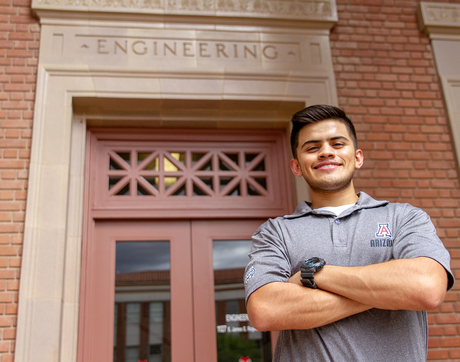 "Engineering freshman Alexis Morales is the last to make his dad's dream of having a ""Wildcat family"" come true. Morales is the youngest of four, and all of his siblings have degrees from or are attending the UA. (Photo: Kyle Mittan/UANews)"