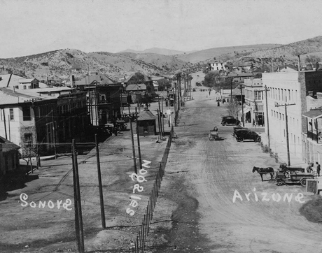 This undated photo from UArizona Special Collections' Southwestern and Borderlands Photograph Collection shows the border between Nogales, Arizona, and Nogales, Sonora, along International Street. (Courtesy of University of Arizona Libraries, Special Collections)