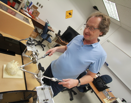 UA Distinguished Professor Jerzy Rozenblit demonstrates his Computer-Aided Surgical Trainer.