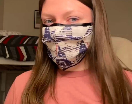 Brittany Faubel in the College of Agriculture and Life Sciences used a reusable shopping bag and ribbon to craft a mask.