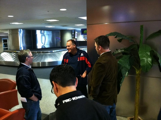 Coach Rich Rodriguez Speaks With Reporters At The Tucson International Airport As He Awaits Arrival