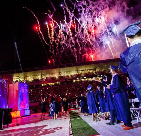 """The ceremony closed with a stellar firework show. During the ceremony, UA President Ann Weaver Hart said: """"To our graduates, we salute you and congratulate you. We are here, all of us, to celebrate your achievement. This evening marks the end of a remarkable journey that I am sure has transformed you in many ways. The most tangible accomplishment is your University of Arizona degree."""" (Photo: John de Dios/UANews)"""