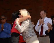 President Ann Weaver Hart hugs a student during the event.