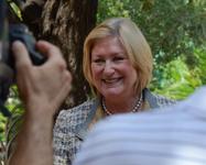 President Ann Weaver Hart speaks to news reporters.