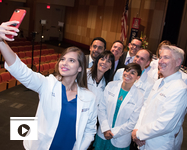 Even the new dean, Dr. Guy Reed (far right), joined in on Zainab Khan's selfie at Friday's White Coat Ceremony at the UA College of Medicine – Phoenix. (Photo: Sun Czar Belous)