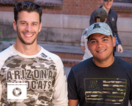 Student veterans John Krause and Manny Alberto Matias modeled Operation Hat Trick merchandise to support military servicemembers and veterans.