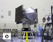NASA's OSIRIS-REx spacecraft rotates on a spin table during a weight and center of gravity test inside the Payload Hazardous Servicing Facility at Kennedy Space Center in Florida. The spacecraft is being prepared for its scheduled launch on Sept. 8. (Photo: NASA/Kim Shiflett)