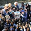 Surrounded by media, trainer Bob Baffert and owner Ahmed Zayat hoist the trophy after their horse, American Pharoah, won the Belmont Stakes on Saturday. (Photo: Horsephotos.com)
