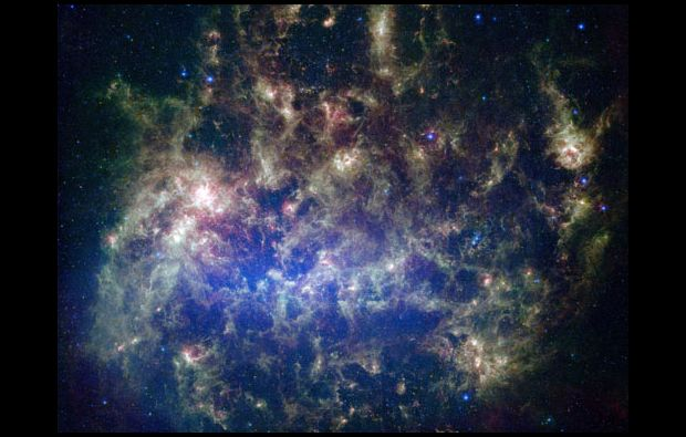 The Large Magellanic Cloud, an irregular galaxy, is visible in the night sky over the Earth's Southern Hemisphere and may contain hidden astronomical wonders yet to be revealed in the images collected by the Large Synoptic Survey Telescope. (Image: NASA)