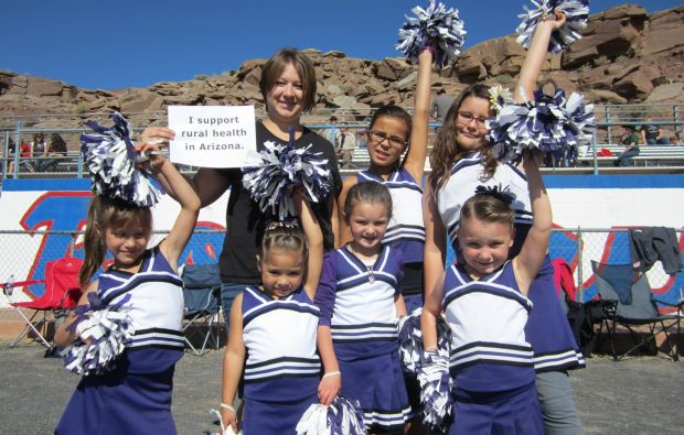 The Longhorn Cheerleaders for the Payson Junior Football League in Payson, Ariz. proudly show their support for rural health in Arizona.