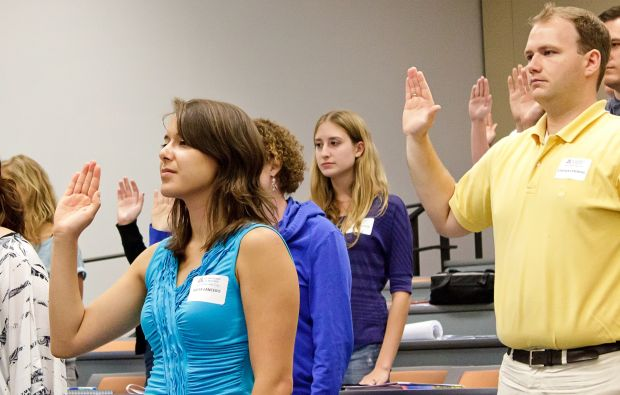First-year law students take an oath at the UA College of Law's inaugural professionalism ceremony.