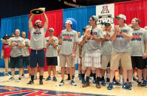 "Wearing T-shirts emblazoned with the words ""Wildcats Own Omaha,"" the baseball team returned to the UA's McKale Memorial Center, where it received red carpet treatment and was welcomed by more than 5,000 fans. (Photo credit: Patrick McArdle/UANews)"