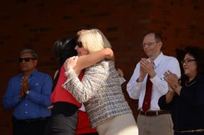 President Ann Weaver Hart hugs a student during the event.