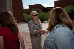 President Ann Weaver Hart shakes hands with her supporters.