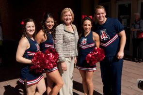 President Ann Weaver Hart poses for a photo with the cheerleaders.