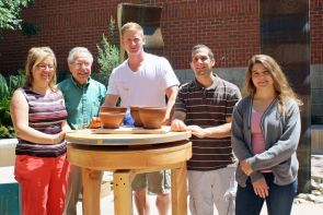 From left: Eleni Hasaki, Michael Schiffer, Steve Carcello, Dan Pont and Katherine Bare with pots created on the replica wheel. (Photo by Beatriz Verdugo/UANews)