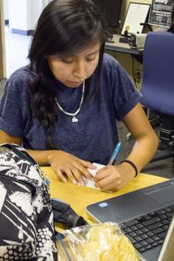 Kierstyn Tsosie, a student in the UA School of Government and Public Policy, takes time to study at the Native American Student Affairs study lounge, a regular meeting space for students. (Photo credit: Beatriz Verdugo/UANews)