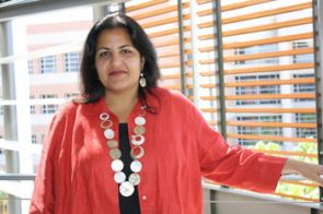 Anita Bhappu said digital, m-coupons forgo the need to ever print coupons and, with the use of a loyalty card or device, would be automatically and electronically redeemed at the register. Her investigation revealed that producers have much to learn if this technology is to be successful. (Photo credit: Beatriz Verdugo / UANews)