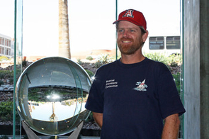 Geoff Bret Harte, with the finished glass sphere in the Museum of Optics. (Photos by Beatriz Verdugo, UA News)