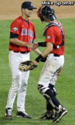 Konner Wade (48) shakes the hand of catcher Riley Moore after the final out.