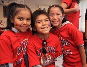 Future Wildcats? Megan June, 8, Taja June, 10, and Joan June, 7, attended the Native American Student Affairs Wildcat Family Pride Weekend luncheon with their father, Keith June, a linguistics major at UA. (Photo credit: Norma Jean Gargasz/UANews)