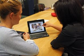 Medical students Katherine Nielsen (left) and Tiffany Son zoom in on an image of a human heart on the Heart Anatomy Explorer I app.