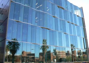 Campus buildings across the campus m all are reflected in the new west wing of the UA College of Optical Sciences.