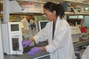 Research scientist Jianing Yang uses the in-house designed and built DNA sample preparation and amplification instrument.