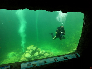 Through large acrylic windows, visitors can look below the surface of the ocean habitat. (Photo: Shelley Littin/UANews)
