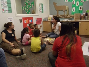 At reading time, children in the UA's speech summer camp program learn about language through stories set in the Desert Southwest. (Photo by Rebecca Vance)