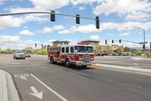 A fire truck responding to a mock emergency incident gets the green light though Daisy Mountain Drive during a live demonstration of the MCDOT SmartDrive traffic management system in Anthem. (Photo courtesy of UA College of Engineering)