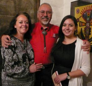 Evelinda Gonzales with her parents, Dr. Carlos and Debbie Gonzales.