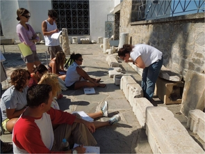 Students measure architectural blocks from ancient temples.
