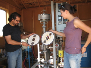 (Click to enlarge) At the desalination research site in Marana, Umur Yenal, who recently earned a PhD, and Andrea Corral, a doctoral student, hold water filtration membranes that are part of a Vibratory Shear Enhanced Processing unit, or VSEP. Water is forced at high pressure through an assembly of 19 of the filters, which are shaken to settle particulates. The process is a highly effective way to reduce salinity in water. .