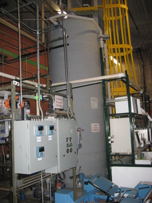 (Click to enlarge) A 2,000-gallon tank of ultra pure water in the water lab. Semiconductor fabrication requires vast amounts of water that must be treated rigorously to eliminate contaminants.