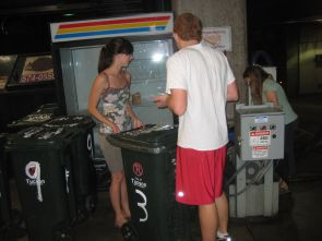 """(Click to enlarge) ASUA students conducting a """"waste audit"""" at the Student Union Memorial Center."""