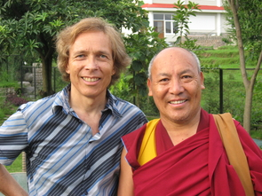 Chris Impey stands with the Venerable Geshe Lhakdor, director of the Library of Tibetan Works, who was for longer than a decade the personal translator for the Dalai Lama. (Photo: Karma Thupten)