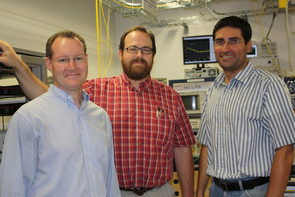 CIAN's TOAN testbed group. From left: John Wissinger, Daniel Carothers and Massoud Karbassian. Jun He and William Duncan do not appear. (Photo by Beatriz Verdugo/UANews)
