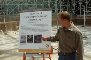 (Click to enlarge) John Adams, assistant director of planning and facilities, explains how a huge Landscape Evolution Observatory project will be constructed in the area where Biospherians once grew their food when locked inside the facility.