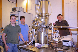 Lab members Matthew Yankowitz, Daniel Cormode and Brian LeRoy (left to right) use a scanning tunneling microscope to make the atomic structures of graphene sheets visible. (Photo by Beatriz Verdugo/UANews)