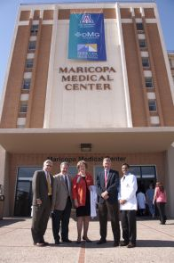 Arizona Board of Regents Chair-Elect Fred DuVal; Dr. William M. Crist, vice president of health affairs for the UA; Betsy Bayless, president and CEO of the Maricopa Integrated Health System; Dr. Stuart D. Flynn, dean of the UA College of Medicine-Phoenix; and Dr. Kote Chundu, president and CEO of District Medical Group, the physicians for MIHS, (left to right) stand outside Maricopa Medical Center on Thursday after a banner was unfurled marking the announcement of the affiliation between the university, the health system and the physicians' group.