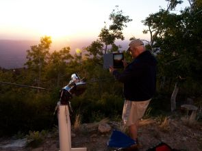 """Amateur astronomer Martin Hamar developed a method to use his iPad to align his telescope with the Sun. """"At night, it's easy because you have Polaris, the North Star, but during the daytime, it's much more difficult,"""" he said. (Photo: Daniel Stolte/UANews)"""