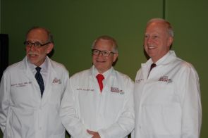 Dr. Robert Arceci, Dr. Daniel Von Hoff and Dr. Timothy Triche, standing left to right, at the announcement of the new Ronald A. Matricaria Institute of Molecular Medicine at Phoenix Children's Hospital in partnership with the UA College of Medicine-Phoenix and TGen.