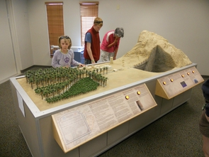 This model, recently installed at Biosphere 2, offers a sneak preview of what the Omani Falaj Water Oasis will look like. The Omani Falaj Water Oasis is a full-scale reproduction of an Arabian desert oasis, which will be a permanent outdoor exhibit a Biosphere 2. (Credit: Biosphere 2)