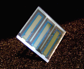 An organic photovoltaic cell on glass. The goal for UA scientists is to understand and control the interfaces in these devices at nanometer-length scales (less than 1/100,000 the thickness of a human hair) to enable the development of long-lived solar energy conversion devices on tough, flexible and extremely low-cost plastic substrates. (click to enlarge)