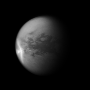 A huge arrow-shaped storm blows across the equatorial region of Titan in this image from NASA's Cassini spacecraft, chronicling the seasonal weather changes on Saturn's largest moon. (Credit: NASA/JPL/SSI)