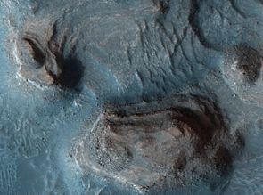 The mesas seens in this false-color HiRISE image are part of another clay-rich region of Mars of great interest to scientists searching for evidence of ancient Martian life. It would take a hiker about 30 minutes to cross this 1.1 kilometer area. (Photo: NASA/JPL/University of Arizona)